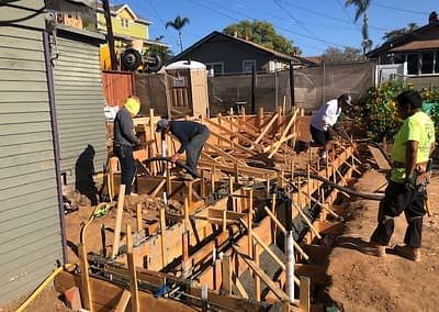 West Coast Building and Design work on a project, showcasing an Caisons, in mid construction to create a beautiful ADU, otherwise known as an Accessory Dwelling Unit